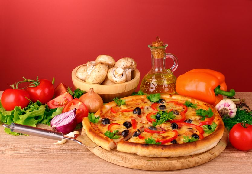 10564769 - pizza and vegetables on a red background