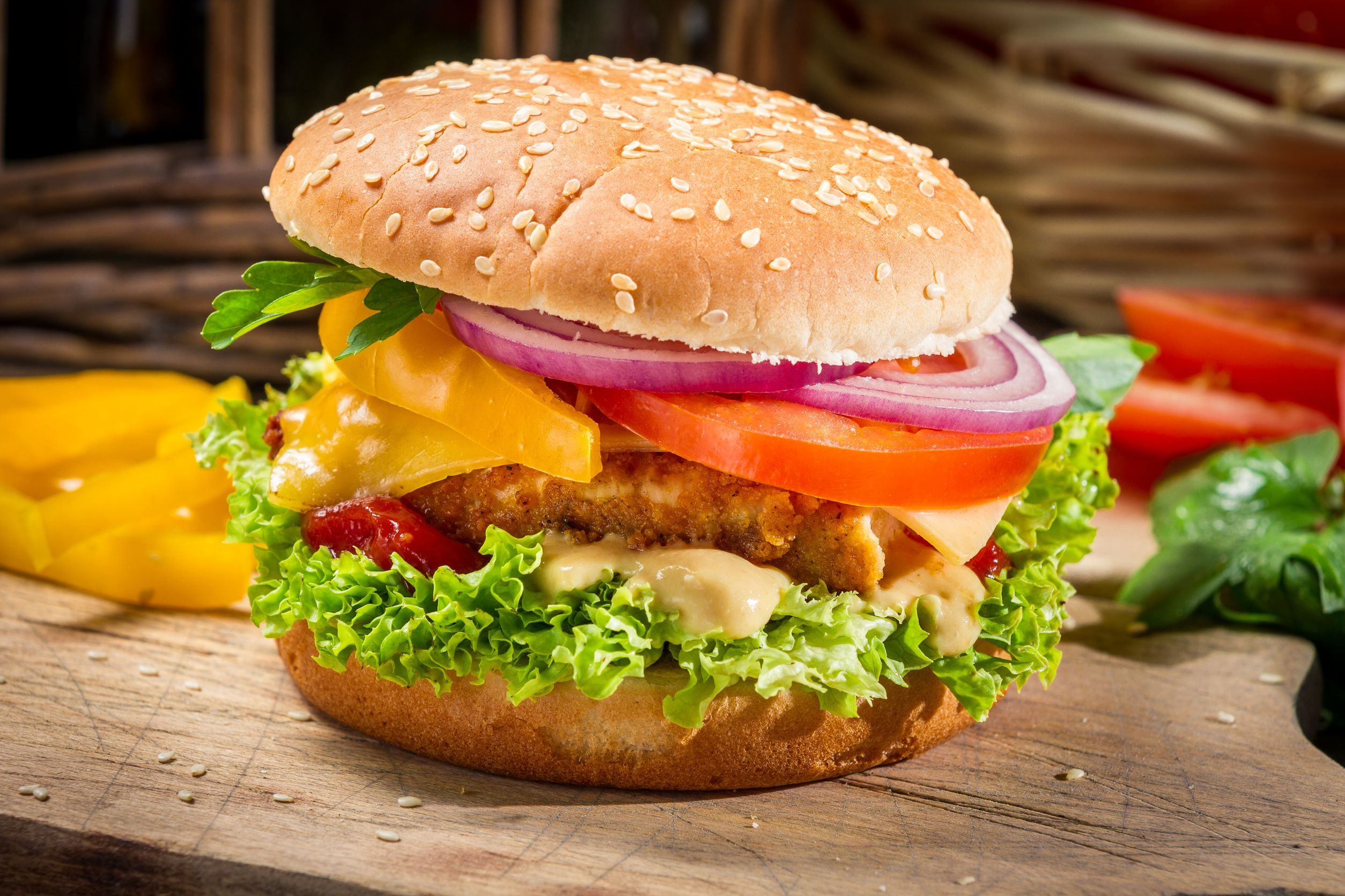 18701029 - closeup of a hamburger with chicken and vegetables