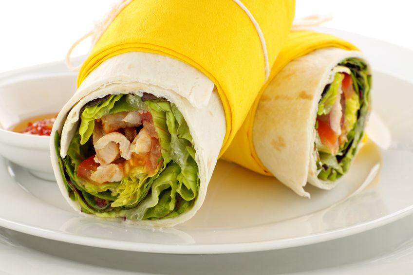 9150635 - delicious spicy chicken wraps in tortillas ready to serve.